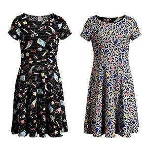 Girls Back To School Dress is reversible. Size 7
